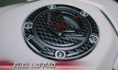 Fuel lid pad
